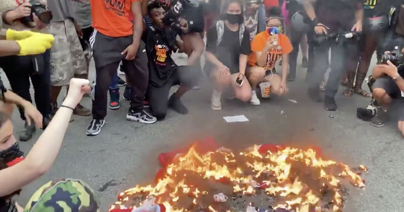 'F**k The American flag': Watch BLM protesters Stomp On & BURN US Flag Outside White House