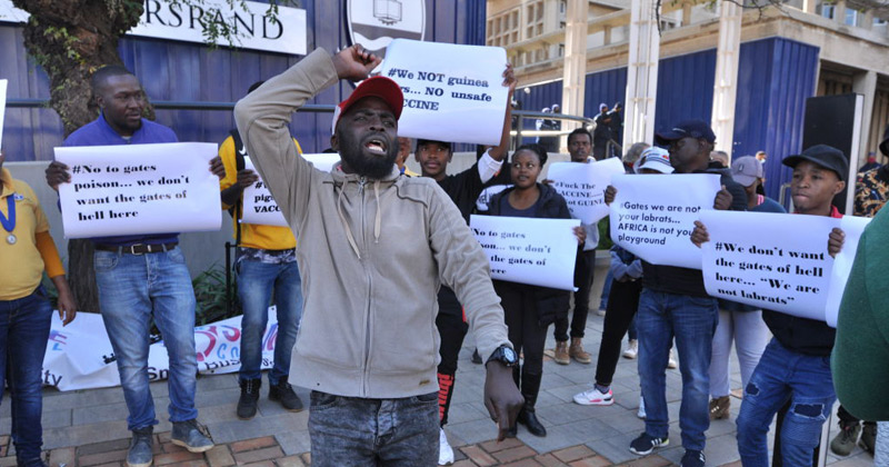 """""""Gates We Are Not Your Lab Rats"""": Africans Protest COVID-19 Vaccine Testing"""