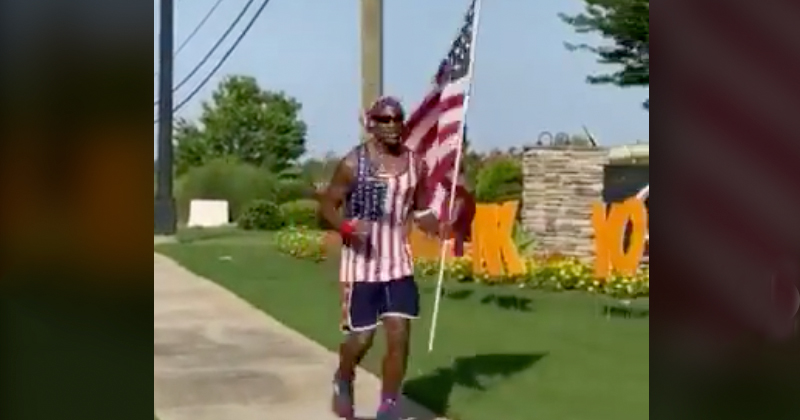 """""""USA! USA!"""": Black Man Promotes """"American Power"""" While Jogging With US Flag"""