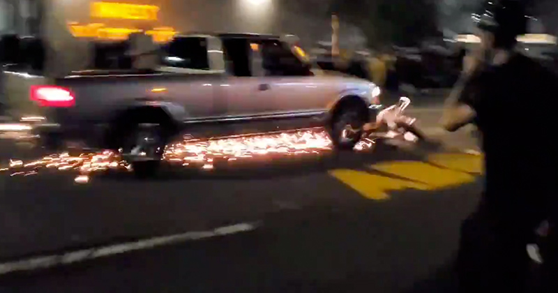 Sparks Fly: Truck Drags Portland Rioter's Motorcycle Down The Street