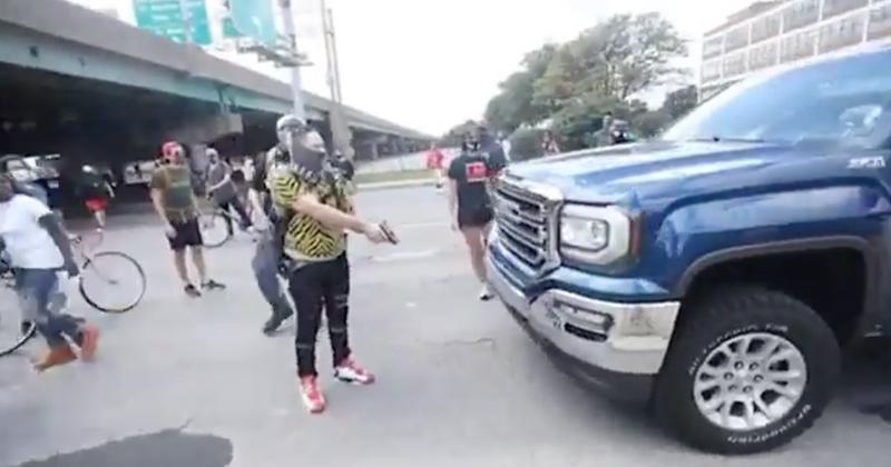 Watch: BLM Protester Blocks Highway, Draws Gun On Motorist