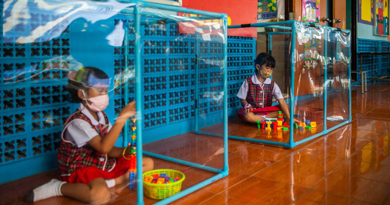 Photos: Thai Students Encased In Plexiglass As Schools Reopen Following COVID Lockdown