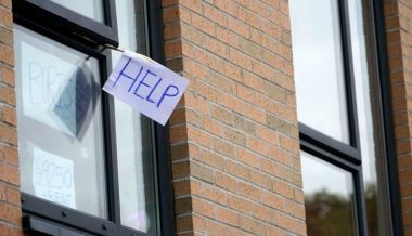 Students Threatened With Police Action For Displaying Anti-Lockdown Signs in Windows